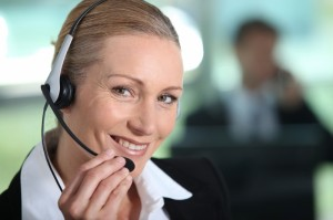 2728162-woman-smiling-holding-headset